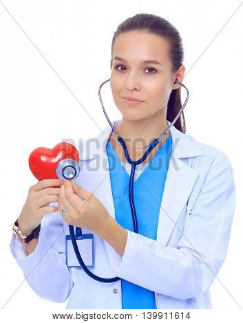 A doctor with stethoscope examining red heart, isolated on white