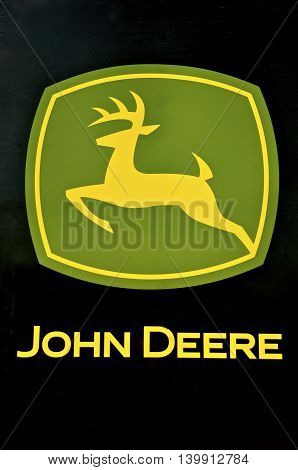Moorhead, Minnesota, July 24, 2016: The running deer and the John Deere words make up the logo for the John Deere Co, an American corporation that manufactures agricultural, construction, forestry machinery, diesel engines, and drivetrains.