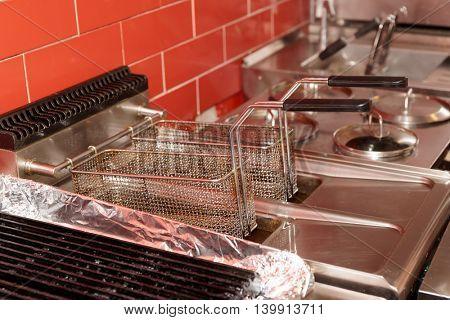 Deep fryer at restaurant kitchen