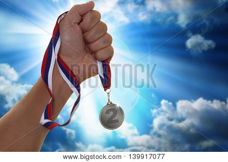 The sportsman holding a gold medal in hand