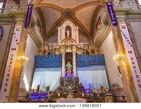 DOLORES HIDALGO, MEXICO -  DECEMBER 29, 2014 Altar Christma Creche Mary Parroquia Cathedral Dolores Hidalgo Mexico. Where Father Miguel Hidalgo made his Grito de Dolers starting the 1810 War of Independence in Mexico. Cathedral built in the 1700s. Signs s