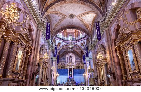 DOLORES HIDALGO, MEXICO -  DECEMBER 29, 2014 Christmas Arches Parroquia Cathedral Dolores Hidalgo Mexico. Where Father Miguel Hidalgo made his Grito de Dolers starting the 1810 War of Independence in Mexico. Cathedral built in the 1700s. Signs say Christm