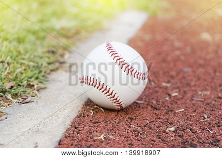close-up baseball on the infield chalk line
