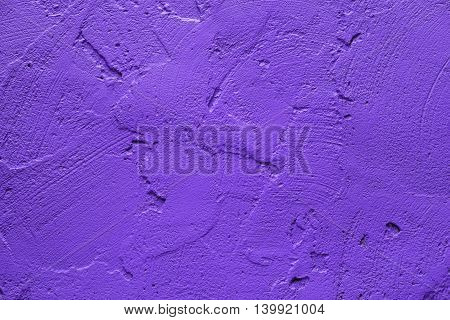 Wall painted in retro vivid purple texture