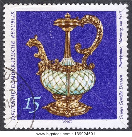 MOSCOW RUSSIA - CIRCA FEBRUARY 2016: a post stamp printed in DDR shows a sumptuous pot the series