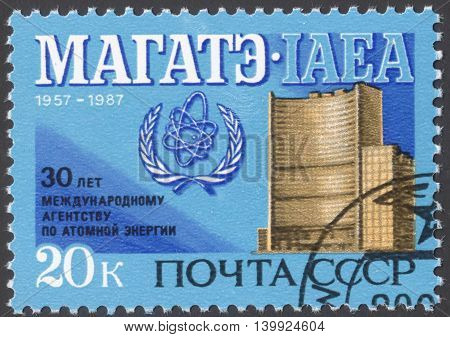MOSCOW RUSSIA - CIRCA FEBRUARY 2016: a post stamp printed in the USSR devoted to the 30th Anniversary of International Atomic Energy Agency circa 1987