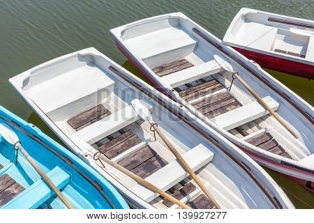 Beautiful top view of wooden rowboats floating around the dock.