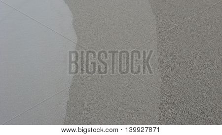 Three grey lines in sand abstract background