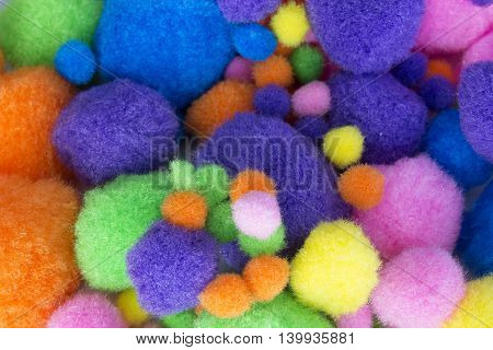 This is a photograph of Fluffy colorful craft Pom Poms