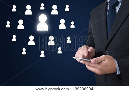 RESOURCES businessman working use smartphone Warm tone man use computer