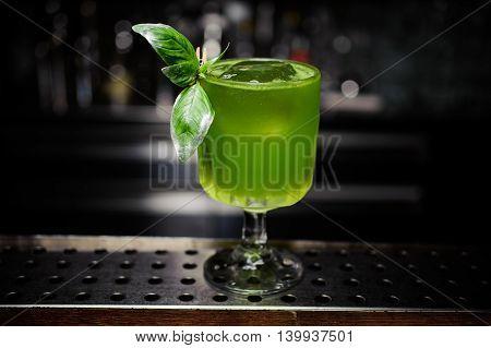 green gin basil smash cocktail at the bar