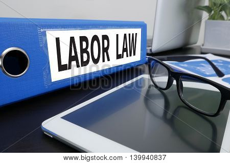 LABOR LAW Office folder on Desktop on table with Office Supplies. ipad poster
