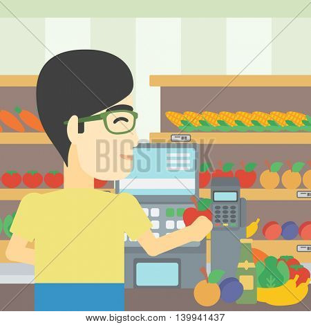 An asian young male cashier standing at the checkout in supermarket. Male cashier working at checkout in supermarket. Vector flat design illustration. Square layout.
