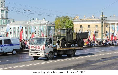 St. Petersburg, Russia - 9 May, Transportation old truck across the bridge, 9 May, 2016. Celebration day of victory in the center of St. Petersburg.