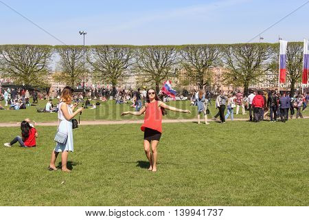 St. Petersburg, Russia - 9 May, People on the green area, 9 May, 2016. Vacationers people on the lawns and gardens in the city.
