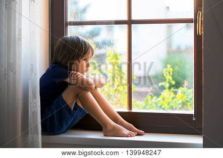 Sad Child, Boy, Sitting On A Window Shield