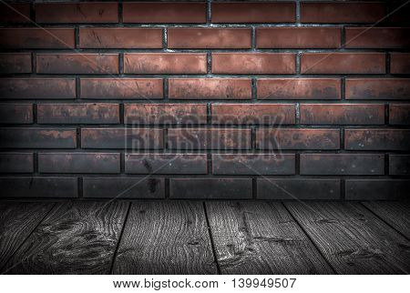 Grungy textured brick wall and wooden floor inside old interior masonry and carpentry brickwork concept