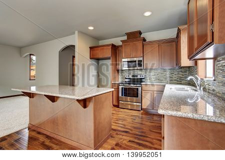 Kitchen Room Interior With Brown Cabinets, Kitchen Island, Granite Counter Tops.