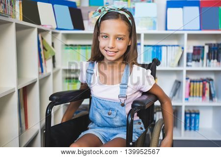 Portrait of disabled smiling schoolgirl in library at school
