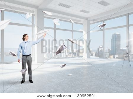 Careless businessman in office . Mixed media