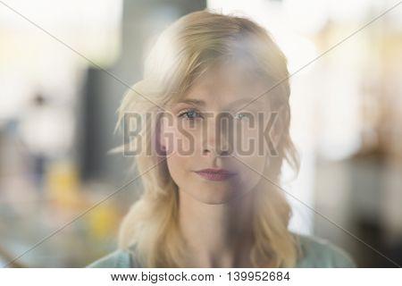 Portrait of beautiful woman in café