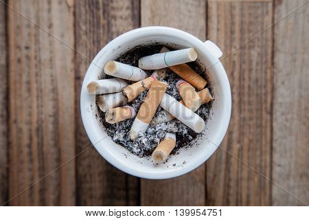 cigarette on a wood table with nature light
