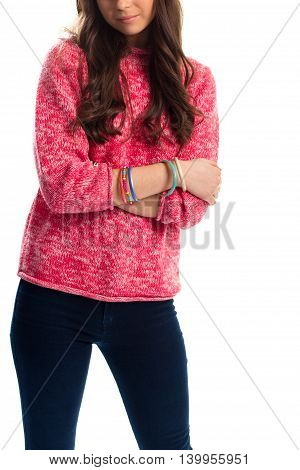 Woman in pink pullover. Bracelets and dark trousers. Accessories and spring apparel. Pants of cotton and stretch.