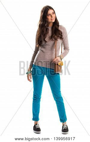 Girl in beige sweater smiling. Two tone bag with strap. Casual outfit with canvas sneakers. Inexpensive clothes that looks good.