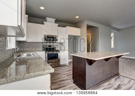 Lovely  Kitchen Room Interior With White Cabinets, Kitchen Island And Granite Counter Tops.