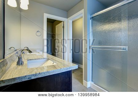 Bright Bathroom Interior With Glass Shower And Tile Floor.
