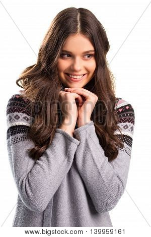 Smiling girl on blank background. Dark pattern on gray pullover. Think up a perfect plan. Smart and cunning face.