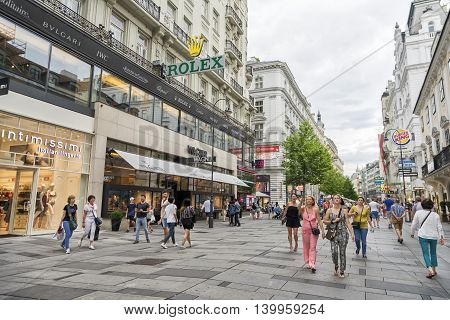 VIENNA, AUSTRIA, JULY 2,2016: People walking at Karntner Strasse (Carinthian Street), the most famous shopping street in central Vienna, Austria.