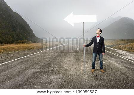 Guy showing roadsign . Mixed media