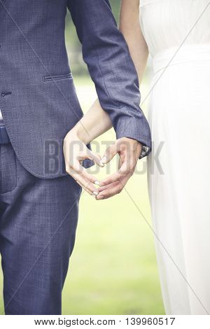wedding - bride and fiance showing heart with hands