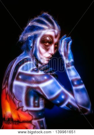 Creative body art. Mystical surreal alien woman.