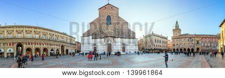 Bologna, Italy - December 27, 2015: Piazza Maggiore with Palazzo dei Banchi and Basilica di San Petronio in Bologna Italy.