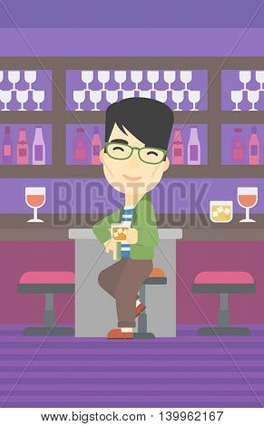 An asian man sitting at the bar counter. Man sitting with glass in bar. Cheerful young man sitting alone at the bar counter. Vector flat design illustration. Vertical layout.