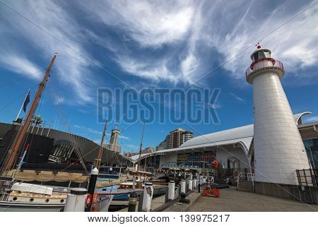 SYDNEY, AUSTRALIA - APRIL, 2016 : View of Cape Bowling Green Lighthouse, submarine, boats in front of the Australian National Maritime Museum, Darling Harbour in Sydney, Australia on April21, 2016.