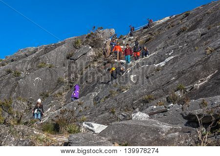 Ranau,Sabah Borneo-March 13, 2016: Group of climbers move down to Laban Rata hut after successfully completed conquering the summit  of mountain Kinabalu at Ranau,Sabah on 13th March 2016