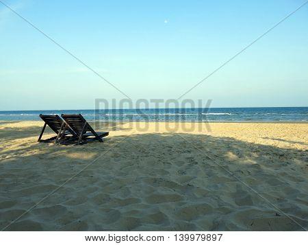 Peaceful beach clear sky white sand and twice beach chair from Thailand
