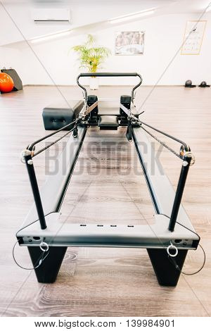 Universal reformer - pilates equipment's close-up ready to be used. poster