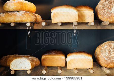 Closeup of an assortment of bakery foodstuffs on shelves