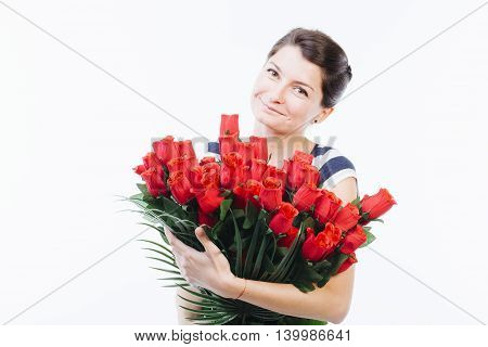 Emotive young woman holding red roses in her hands - isolated on white
