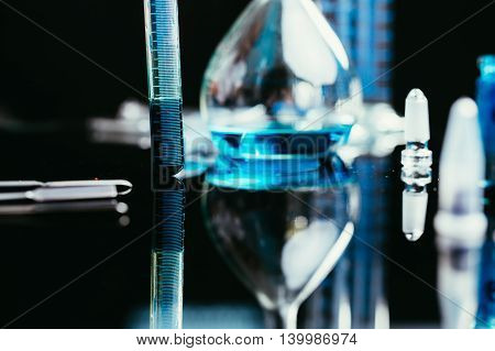 Image of chemistry laboratory equipment : tubes pipettes Erlenmeyer flask