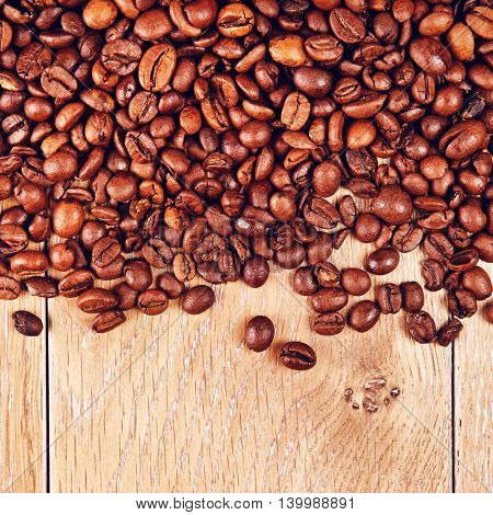 roasted coffee beans on wooden table, background