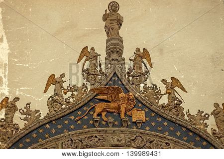 Winged lion symbol of Venice Italy. Old postcard. Vintage processing.