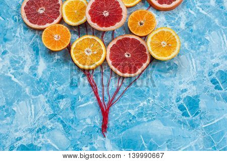 Orange tangerine and grapefruit in conjunction as balloons
