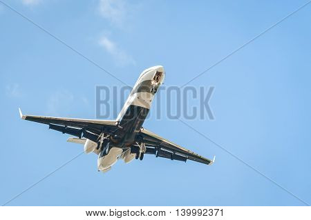 small corporate business jet on landing approach with copy-space