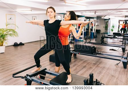 Beautiful girl exercising with her personal trainer