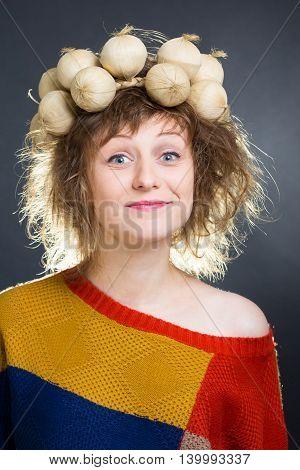 Beautiful rumpled woman wearing a vegetable torse